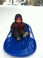 Baby's 1st snow and having a blast !