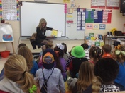 Megan West reads to kids