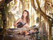 Girl in Tree enjoying Nature