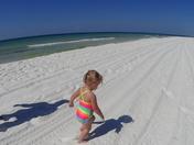 Granddaughter walking Santa Rosa Beach