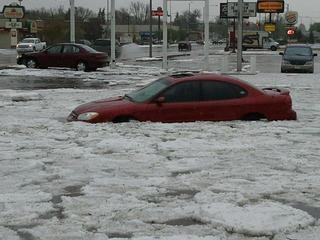 Massive Hail Drifts and Serious Flash Flooding Norfolk, NE