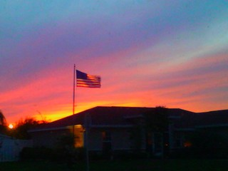 Beautiful sunset over our house with the American Flag flying