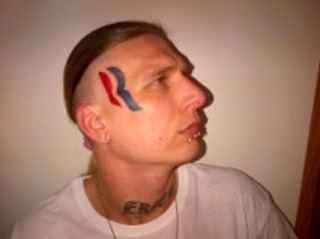 MAN PAID TO TATTOO THE ROMNEY R LOGO ON FACE