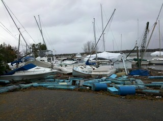 Boats flipped onto the street. Storm damage