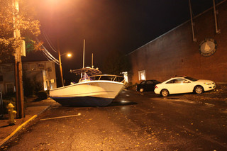 Sandy's Strong Winds washes this boat ashore in South Norwalk, CT